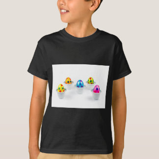 Painted easter eggs standing in porcelain egg cups T-Shirt