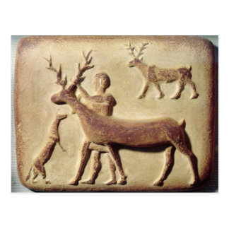 Painted relief depicting a man with deer postcard