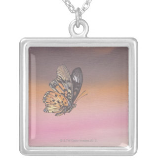 Painting depicting butterfly in flight square pendant necklace