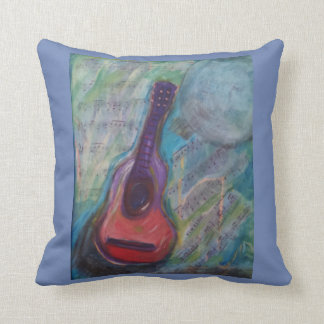 Painting of guitar with moon and music cushion