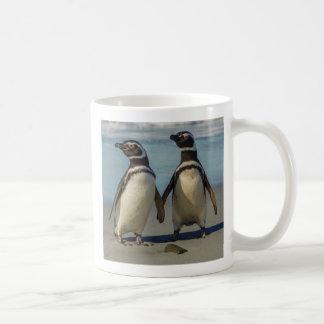 Pair of penguins on the beach coffee mug