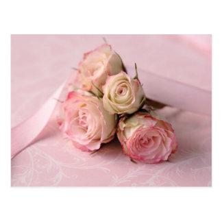 pale roses on pink swirls postcard