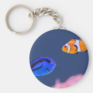 Palette surgeonfish and clown fish swimming key ring