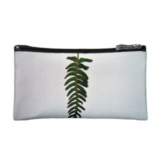 Palm leaf isolated on white background cosmetics bags