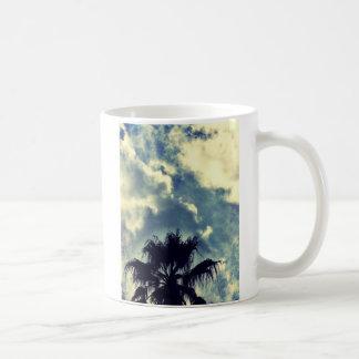Palm tree and clouds coffee mug