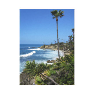 Palm trees and sand - view on the Pacific Ocean Canvas Print