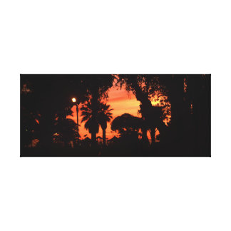 Palm trees silhouette at sunset canvas print