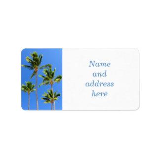 Palms on blue sky background address label