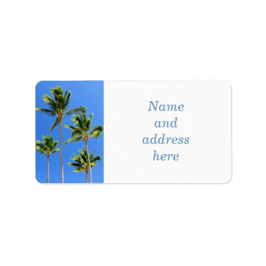 Palms on blue sky background label