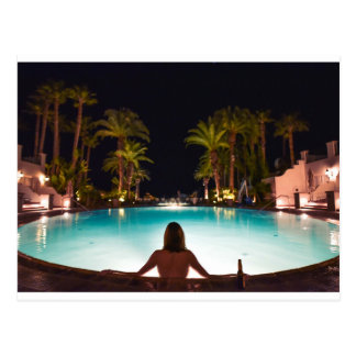 Palms, pool, woman and beer... postcard
