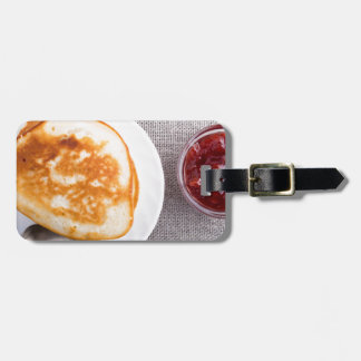 Pancakes and a glass cup with strawberry jam luggage tag