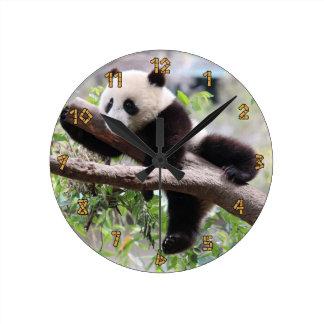 Panda Cub Relaxing In a Tree Round Clock