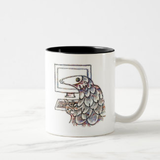 Pangolin on a computer Two-Tone coffee mug