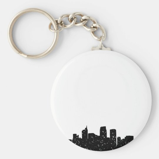 Panorama city in snow key ring