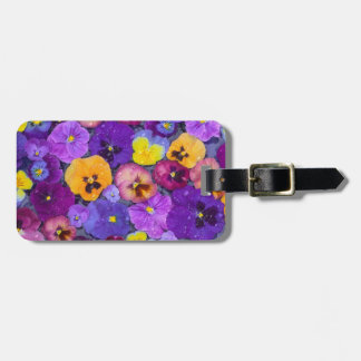 Pansy flowers floating in bird bath with dew luggage tag