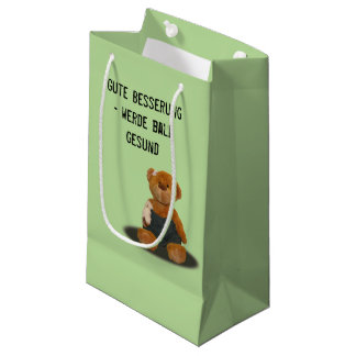"paper bag with ""good improvement"" teddy"