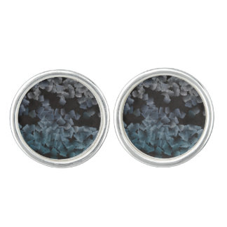 Paper pieces on the ground cuff links
