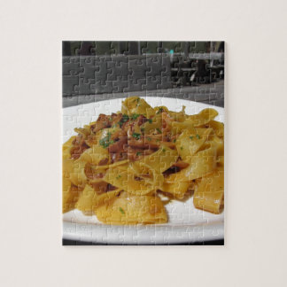 Pappardelle with mushrooms on rustic outdoor table jigsaw puzzle
