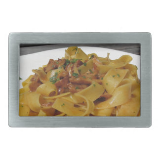 Pappardelle with mushrooms on rustic outdoor table rectangular belt buckle