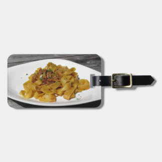 Pappardelle with mushrooms on rustic wooden table luggage tag