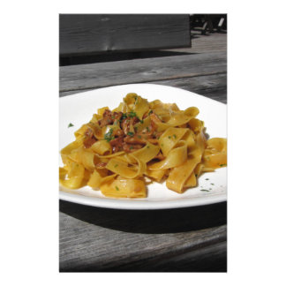 Pappardelle with mushrooms on rustic wooden table stationery