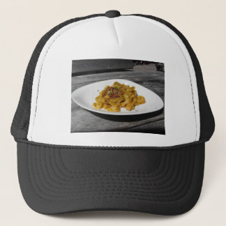 Pappardelle with mushrooms on rustic wooden table trucker hat