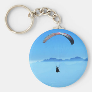 Paraglider on blue background with mountains basic round button key ring