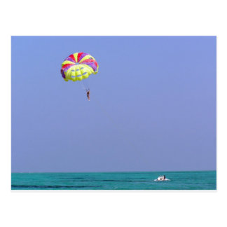 Parasailing over the blue water postcard