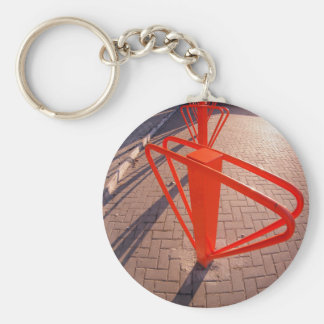 Parking for bicycles in the street closeup key ring