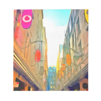 Passage between colorful buildings notepad