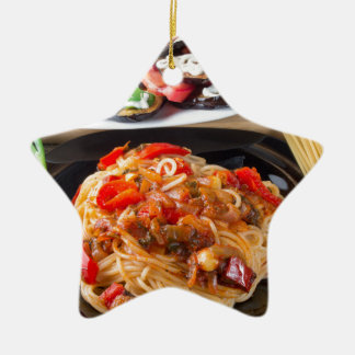 Pasta spaghetti with pieces of bell pepper ceramic ornament