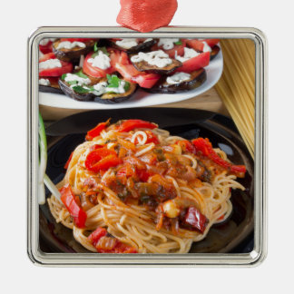 Pasta spaghetti with pieces of bell pepper metal ornament