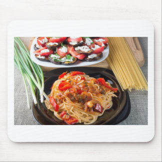 Pasta spaghetti with pieces of bell pepper mouse pad