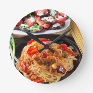 Pasta spaghetti with pieces of bell pepper round clock
