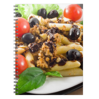Pasta with bolognese sauce, beef meat, olives spiral notebook
