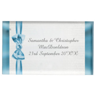 Pastel blue bow and white traditional wedding place card holder