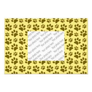 Pastel yellow dog paw print pattern photo