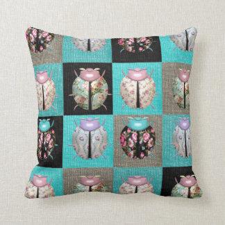 Patchwork ladybird cushion