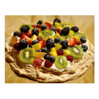 Pavlova garnished with colorful fruits postcard