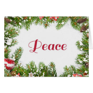 Peace message framed in snow-covered pine needles card