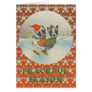 Peaceful Season: Skating Australian Cattle Dogs Greeting Card