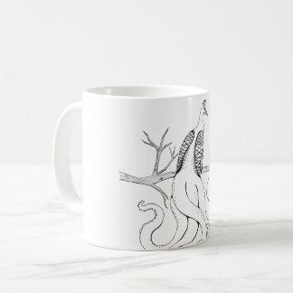Peacock on a branch coffee mug