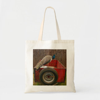 PEACOCK RESTING ON OLD RED TRAILER TOTE BAG