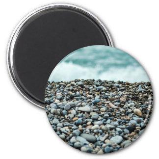 Pebbles at sea shore 6 cm round magnet