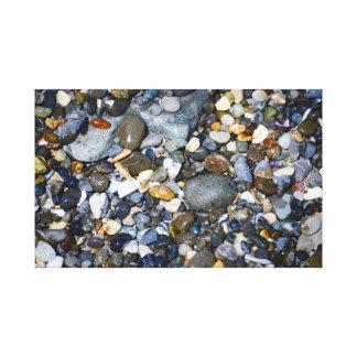 Pebbles on a Beach Canvas Print