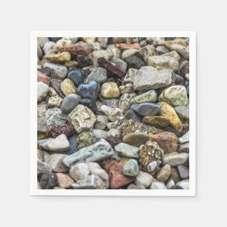 Pebbles on a beach disposable napkins
