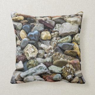 Pebbles on a beach throw cushion