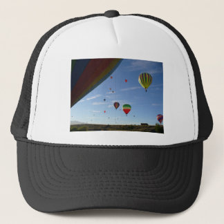 Peeking out trucker hat