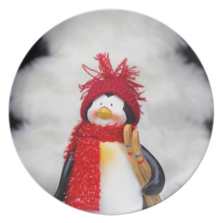 Penguin figurine with white christmas tree plate