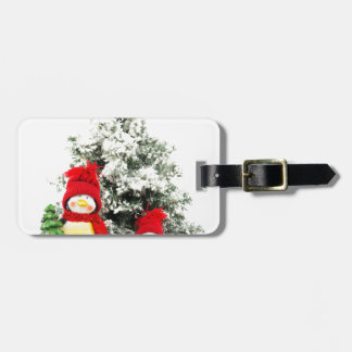 penguin figurines with christmas tree in winter bag tag